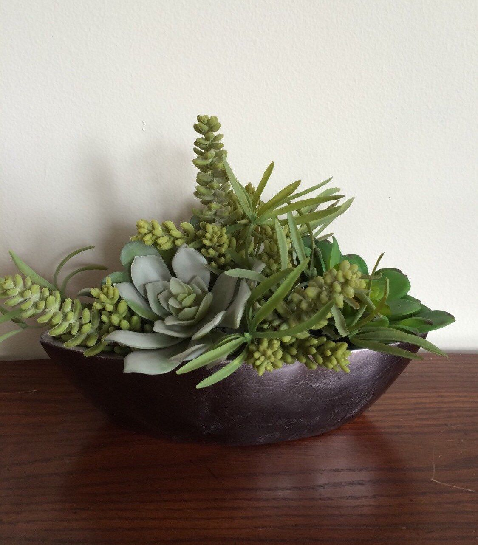 Faux succulent centerpiece in ceramic gray metallic boat