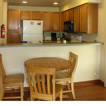 Ideally, each family would have their own kitchen and dining area. Kitchens within individual units/apartments allow residents to determine what they (and their children) eat and when, something their abuser may have disrupted. Individual kitchens also ease religious observances regarding food and cooking utensils and thus increase the cultural accessibility of the shelter.