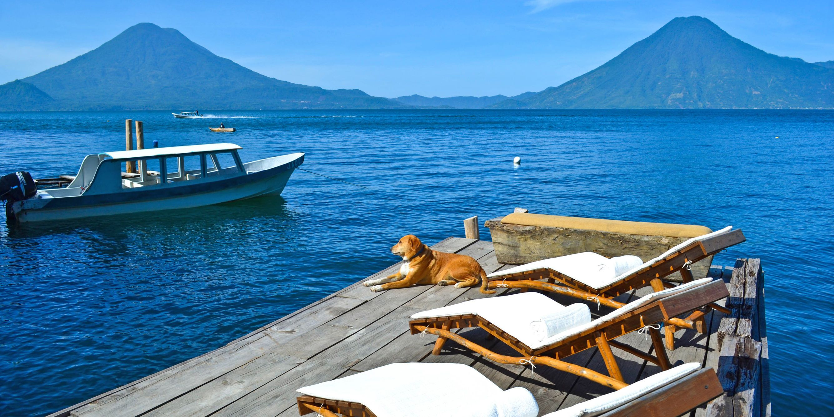 Laguna Lodge Eco Resort Nature Reserve Santa Cruz La Guatemala Ocean Scenic Views Sea Water Sky Mountain Boat Wooden S Pier Coast Watercraft