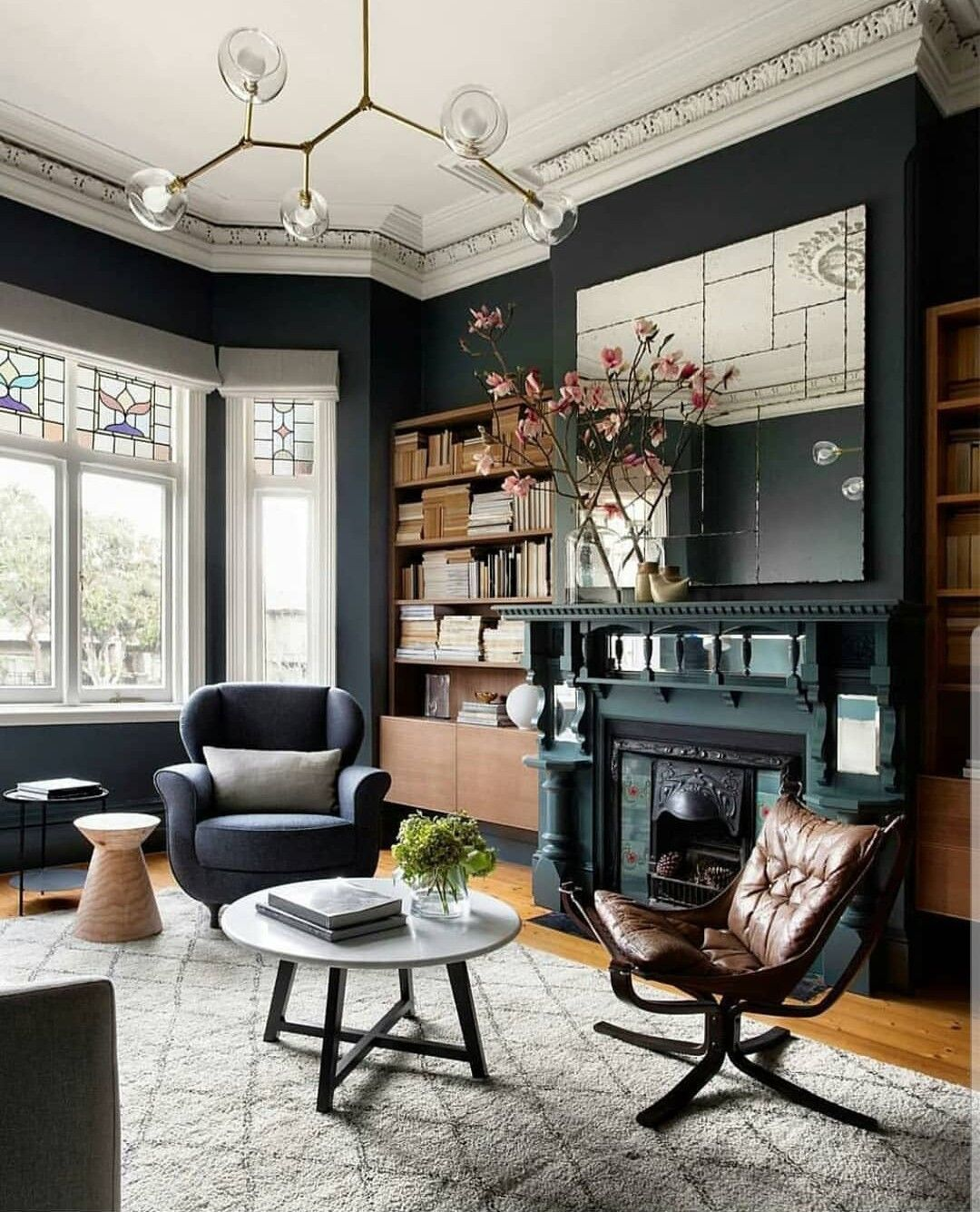 Living room library green walls stained glass fireplace