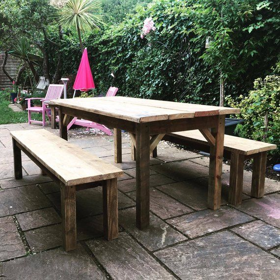 Garden Table and 2 Timber Benches is part of Reclaimed garden Table - Made to Order This handmade farmhouse table is made from reclaimed and recycled scaffolding boards  The wood has been sanded down to make a smooth finish but with the age and characteristics that make the table unique have been kept  It is then coated with a teak oil to protect the wood and bring out the grain  This means that the table is suitable for inside as a dining table and outside as a garden table  Size Guide  Four people Length 88 cm Width 88 cm Height 77cm Bench size Length 88cm Width 35cm Height 45cm  Six people  Length 150 cm Width 88cm Height 77cm Bench size Length 150cm Width 35cm Height 45cm Eight people Length 180 cm Width 88cm Height 77cm Bench size Length 180cm Width 35cm Height 45cm Please contact for any other sizes  Delivery When the item is complete I will send you some images to make sure that you love it before sending it  The item will be sent with the legs detached for easy trasport unless stated otherwise   Please ask any questions in regards to this table as I will be happy to answer! )