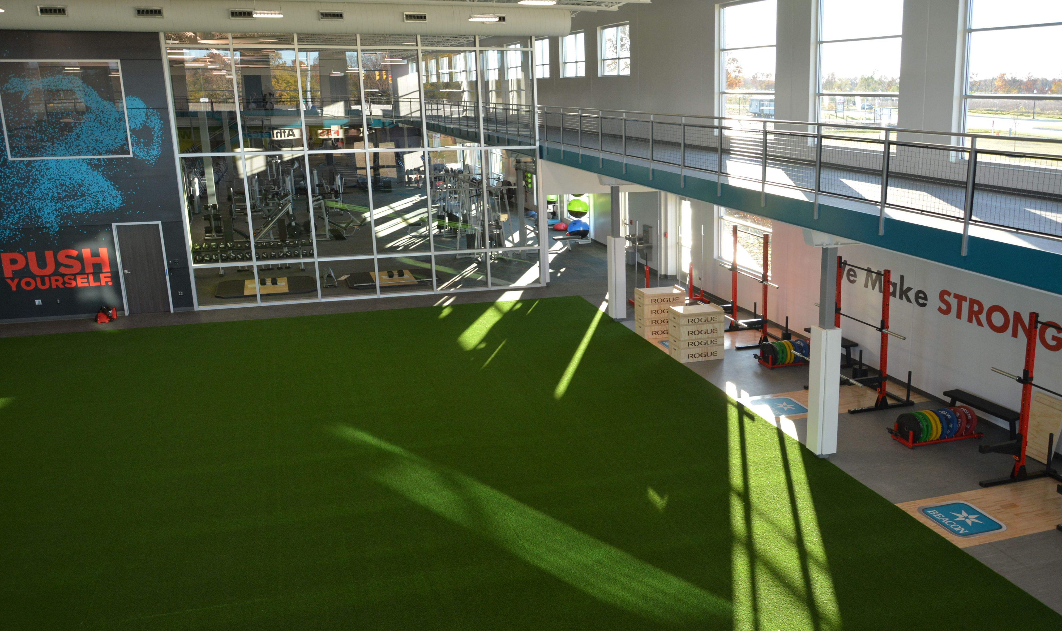 Sports Performance The New 67 000 Sg Ft Facility Has Everything Needed For Fitness Within The Gym Traini Floor Workouts No Equipment Workout Indoor Sports
