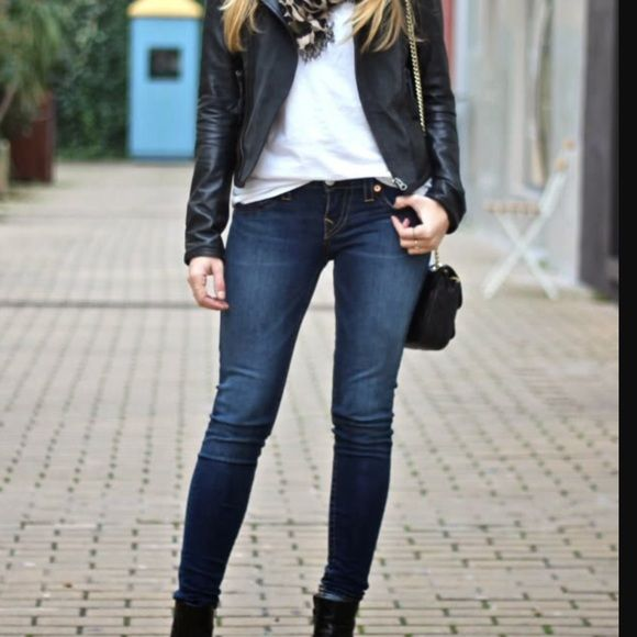 Dark skinny jeans and black boots