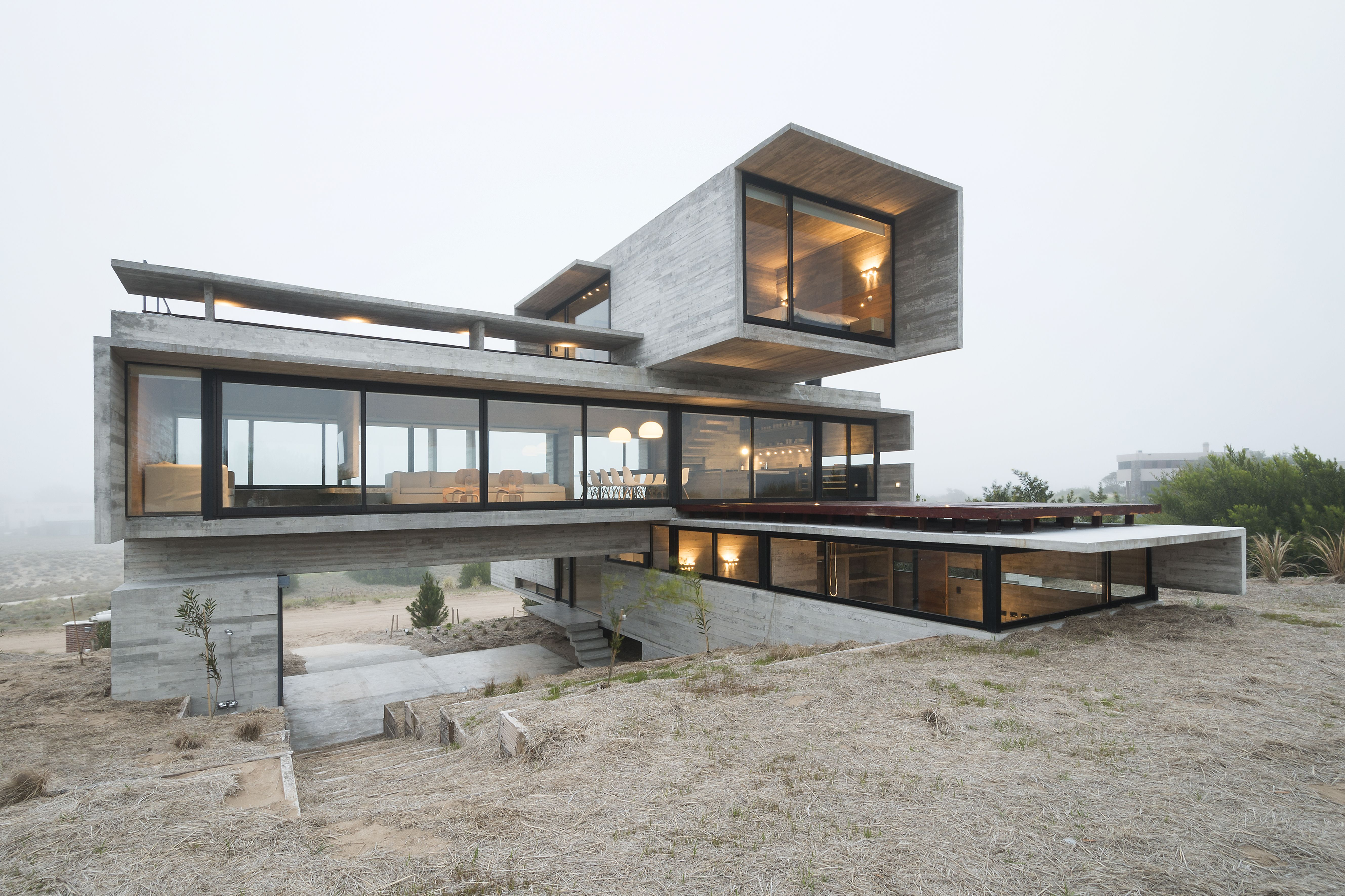 Photo 2 Of 17 In This Stacked Concrete Home Is Not Your Typical Golf Concrete House Glass House Design Concrete Houses