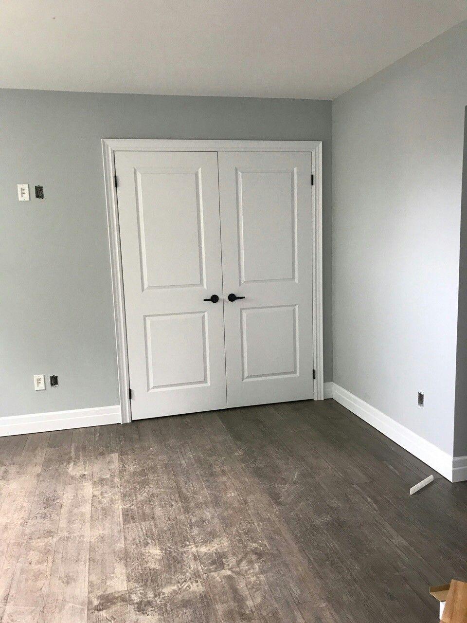 Master Bedroom Reno Walls Whitestone Benjamin Moore Is A Lovely Blue Gray Floors Oak Lava 10mm Laminate Pla Grey Walls Grey Laminate Flooring White Doors