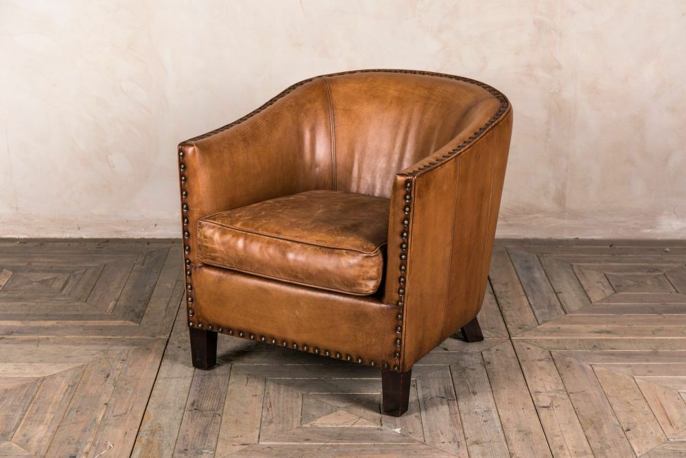Leather tub armchair brass studded bucket chair ...