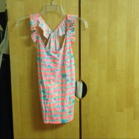 Lilly Pulitzer Tank Top size medium this is the most precious tank top ever! it has slight ruffle detailing on the straps and looks adorable on! I'm not quite sure what the print is called, but it has only been worn once (as shown in one of the pictures). I'm also not certain of the original price, but I'm almost positive it was around $80. let me know if interested!! Lilly Pulitzer Tops Tank Tops