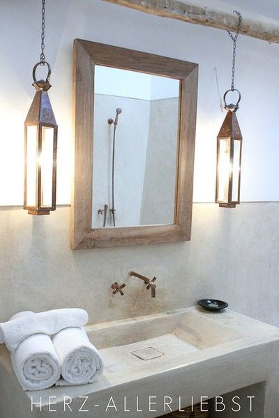 Lanterns in the bathroom? Could see this in a small hotel or rustic/modern house...