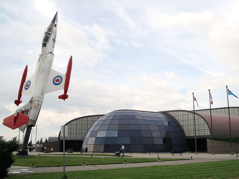 Canadian Warplane Heritage Museum exterior. The aircraft placed as a monument in front of the museum building is the two-seat version of the CF-104 Starfighter