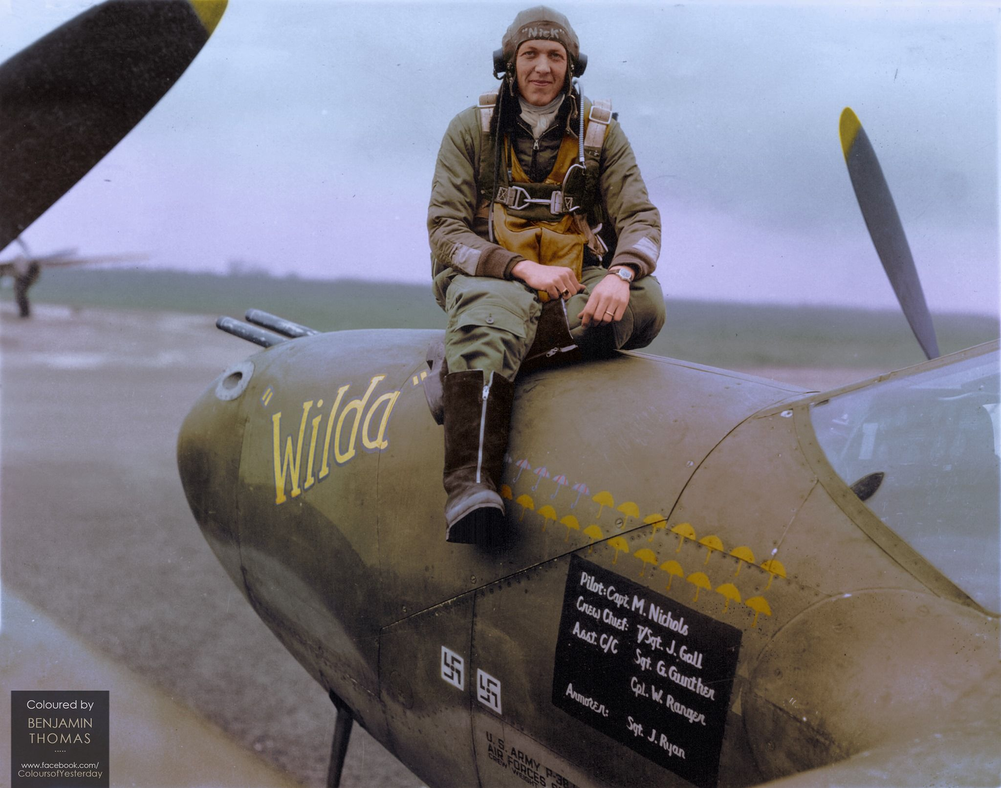 "Captain Merle B. Nichols seated on the nose of ""Wilda"