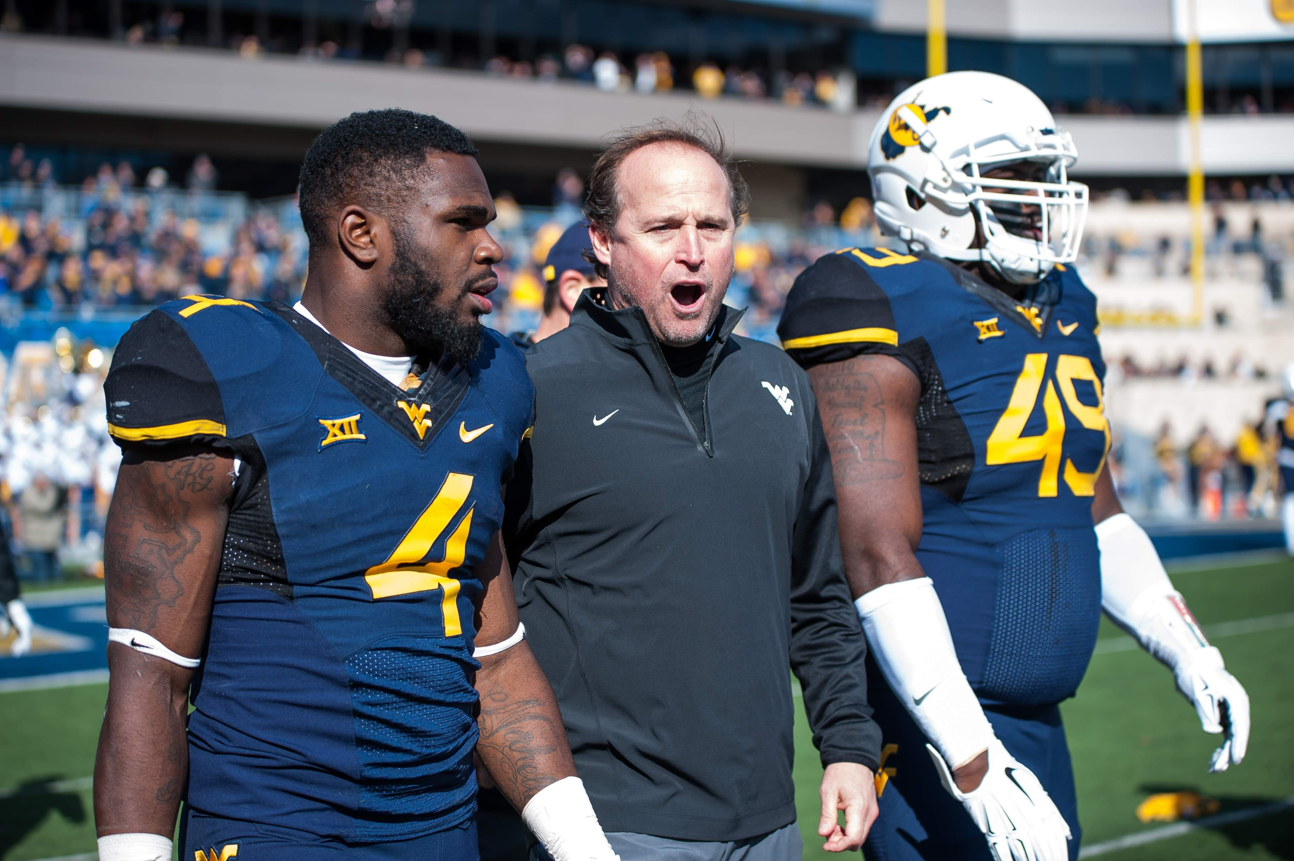 Charleston Gazette-Mail | Mitch Vingle: Holgorsen, special teams catch big wave in WVU win