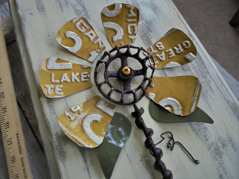 Faucet handle license plate flower assemblage wall hangingfolk art