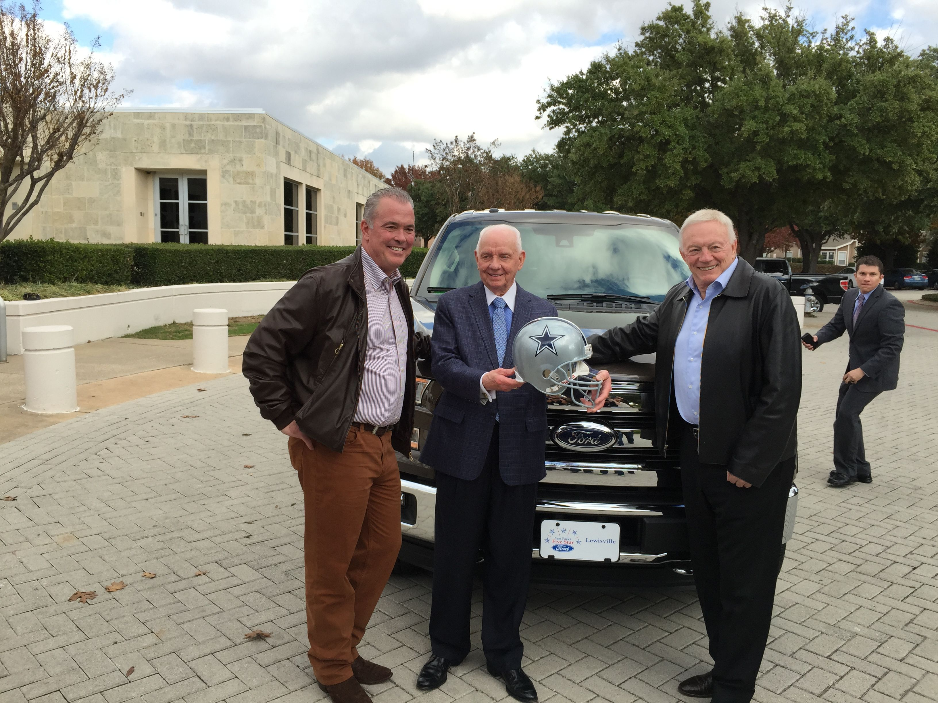 DFW s First 2105 Ford F 150 presented by Sam Pack to Stephen Jones