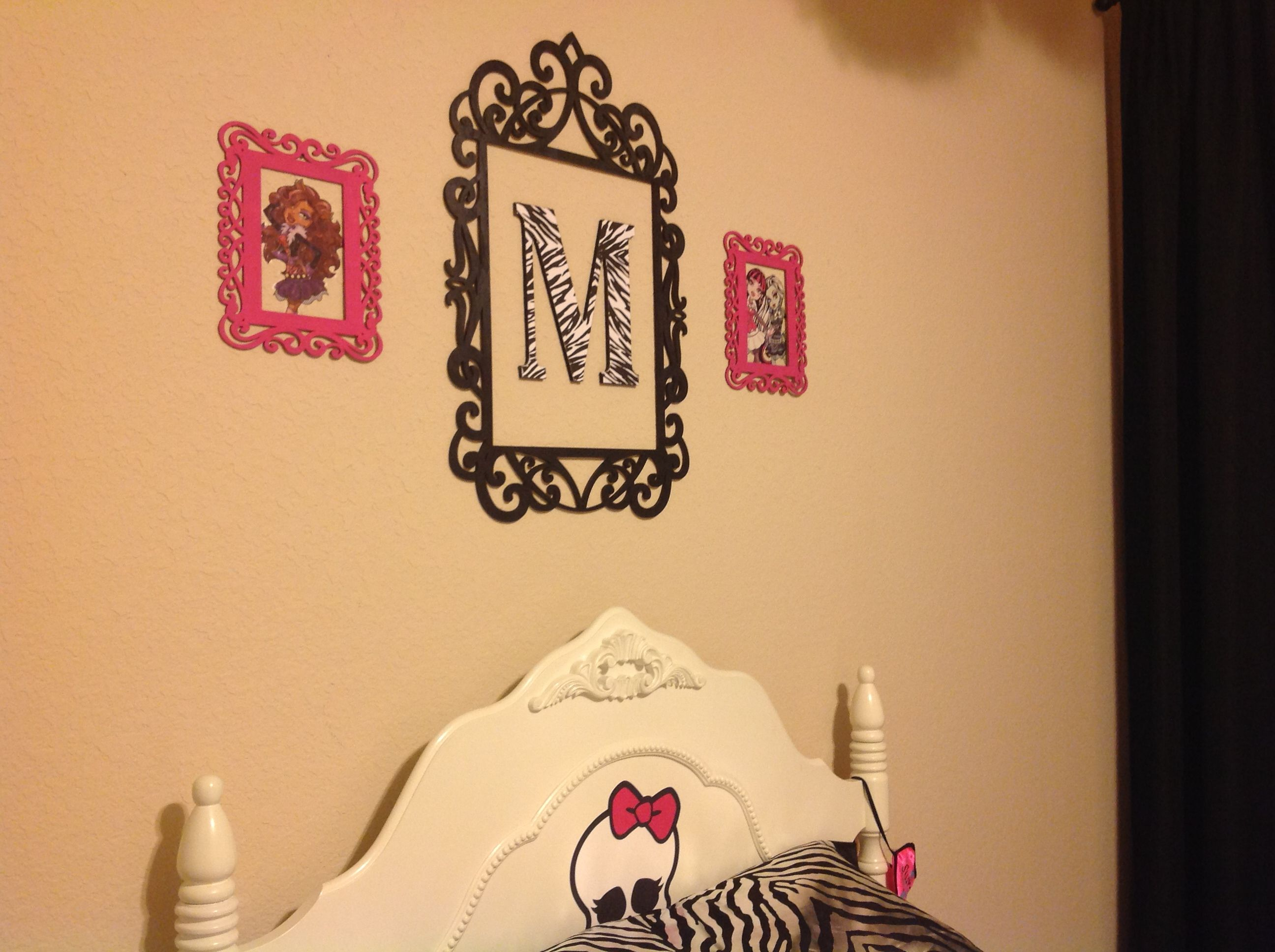 I painted wood frames from Michaels. Zebra letter also from Michaels ...