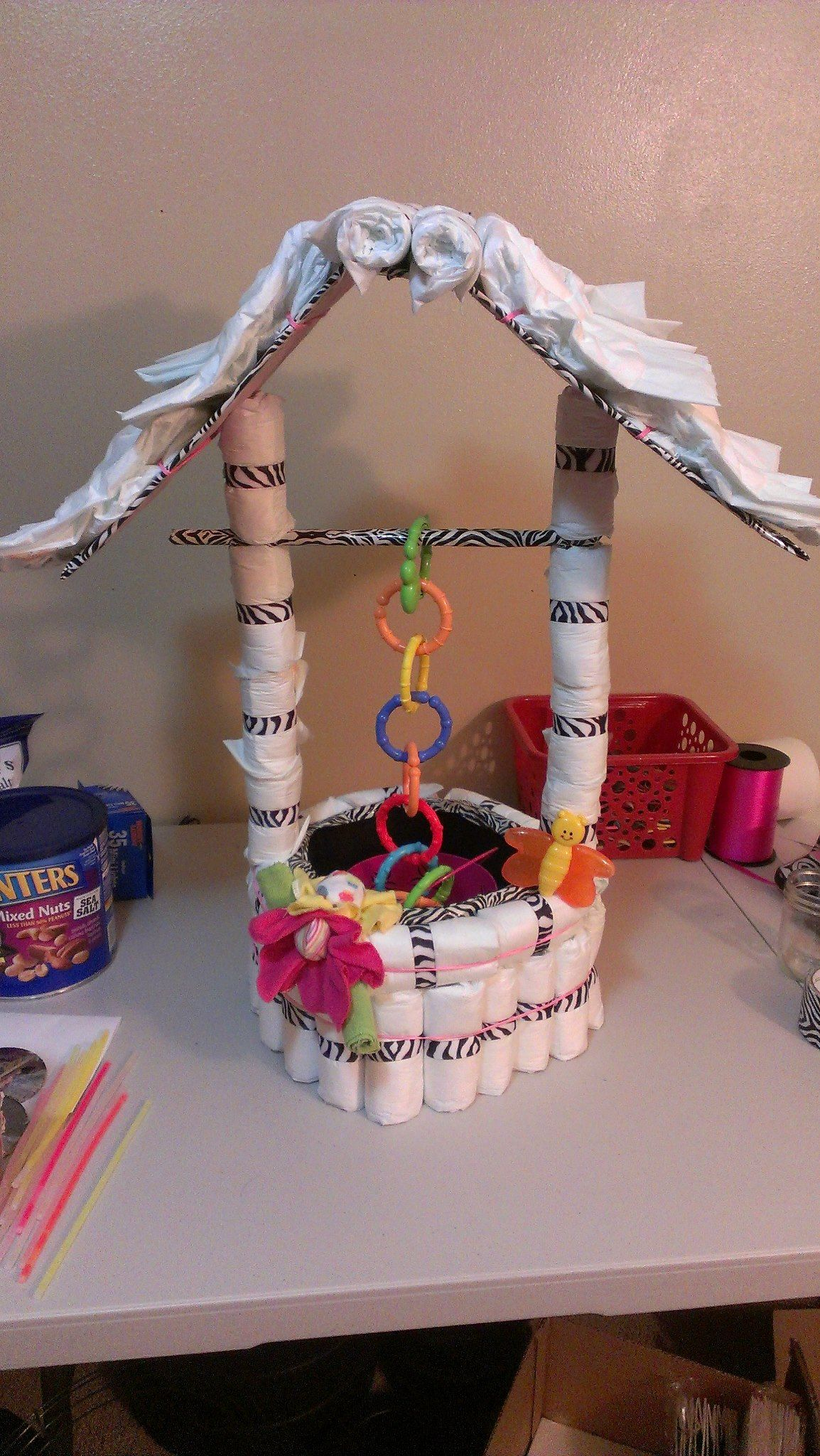 My very own idea and creation a wishing well made out of diapers