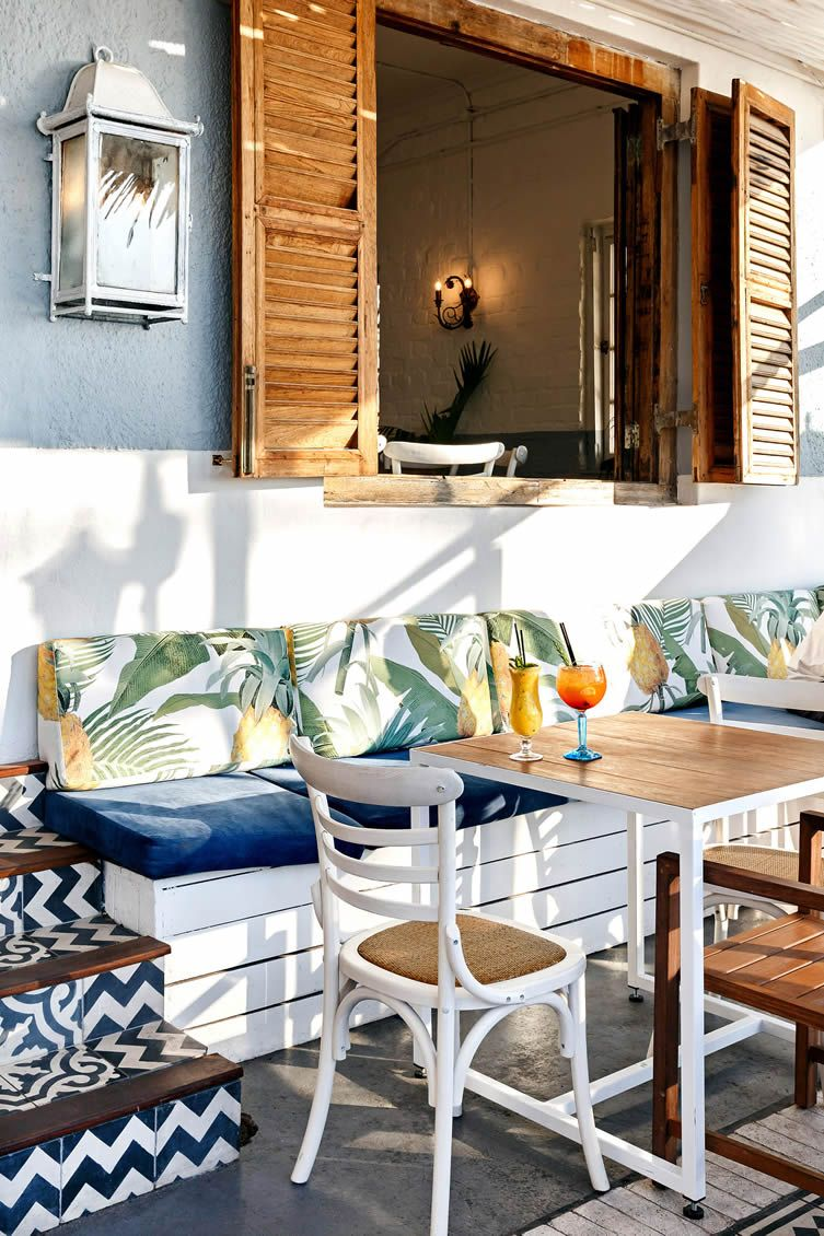 Balearic bliss and retro tropical aesthetics inform a for Tropical hotel decor