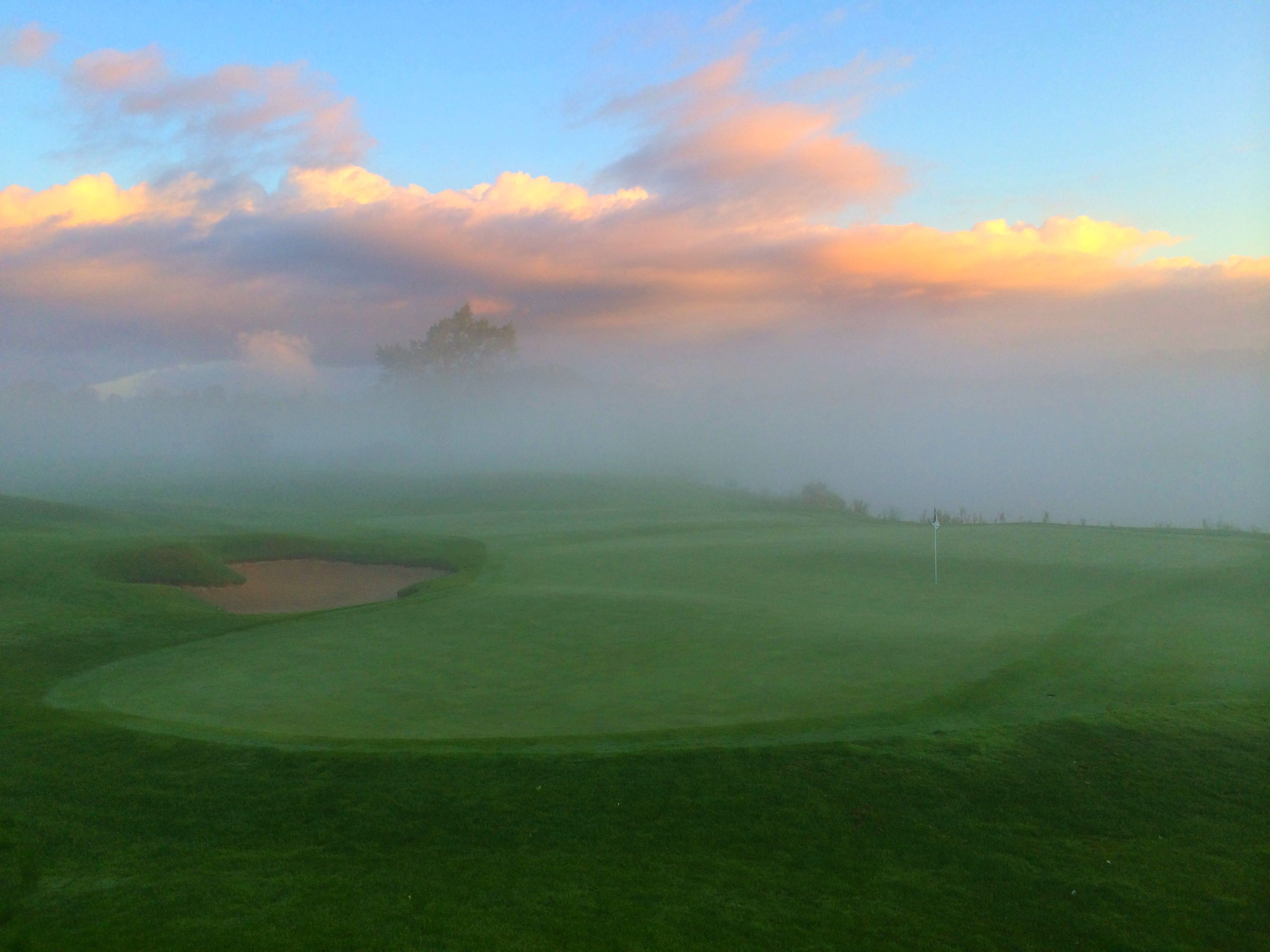Hole #18 on The Bear at Grand Traverse Resort and Spa on a foggy morning.