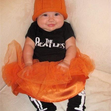 A cute little pumpkin wearing BabyLegs Bones legwarmers - Click