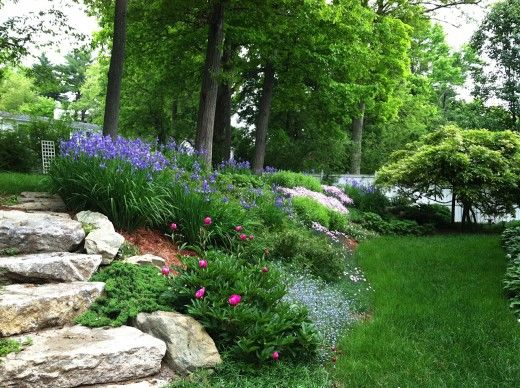 Slope landscaping with stone this steep slope was for Ideas for landscaping large areas