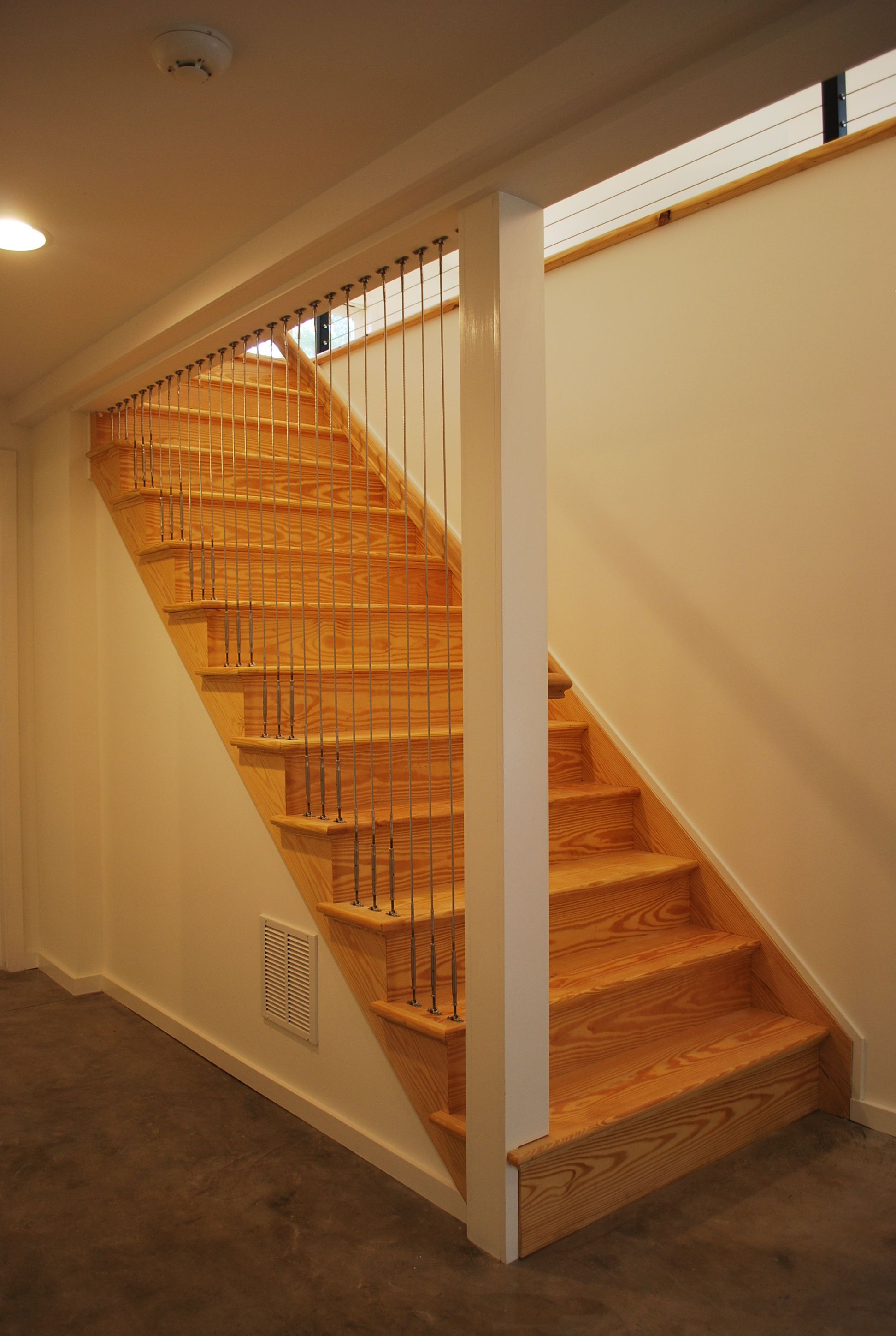 Natural Stain Staircase With Metal Cable Rail Railing For An