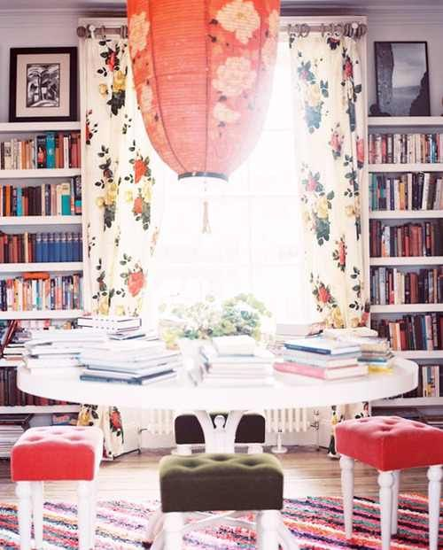 A home made library sitting area luv the big paper asian lantern & flowered curtains with velvet sitting stools.