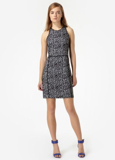 Leopard Knit Shift | Rebecca Taylor  $325.00  The eternally stylish leopard print gives a classic knit shift dress a wild side! Finished with solid black contrasts at the trim and back panel. Inverted back zip closure.