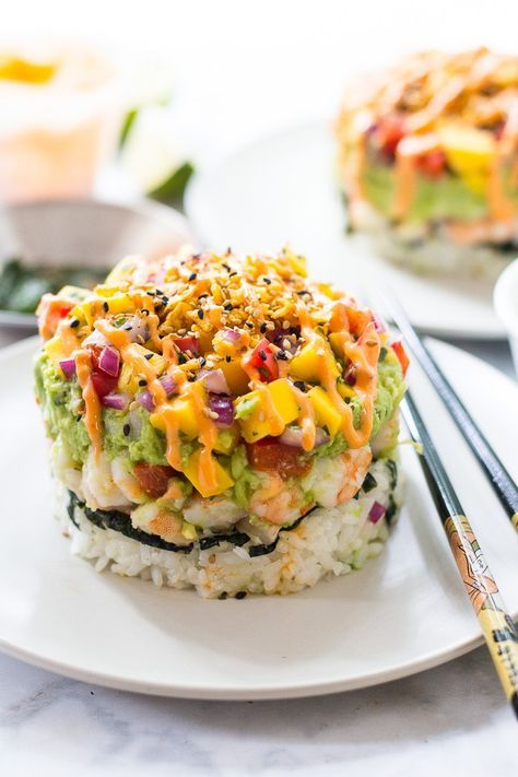 These Spicy Shrimp Stacks with Mango Salsa are a fun twist on a spicy California roll, topped with a quick guacamole and drizzled with spicy-sweet Bang Bang sauce!