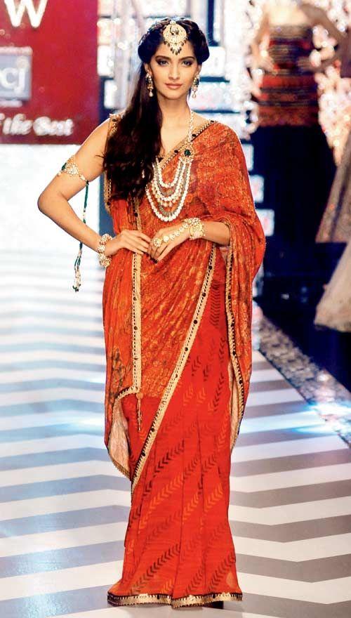 Sonam Kapoor - a maang tika and a heavy pearl set