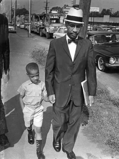 Noted civil rights activist Dr. Sonnie W. Hereford III, holds the hand of his young son, Sonnie Hereford IV, as they walk away from Fifth Avenue Elementary School on Sept. 6, 1963. Sonnie Hereford III and Sonnie Hereford IV They'd been turned away by state troopers dispatched by Gov. George Wallace to enforce segregation. morning of Sept. 9, 6-year-old Sonnie IV would become the first black child to enroll in a previously all-white school in the state of Alabama.