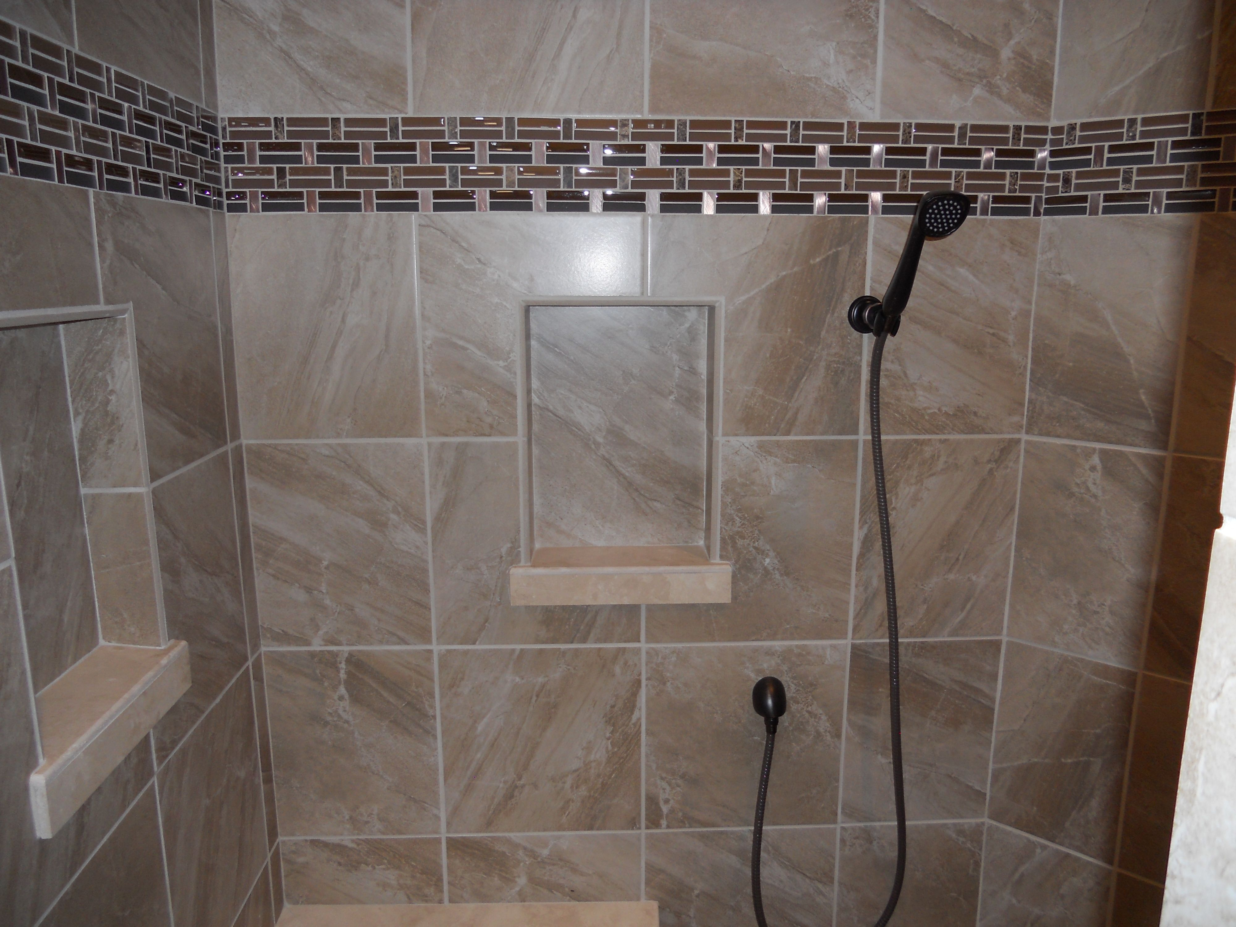 Beautiful tile shower with shampoo niches and glass tile deco band ...