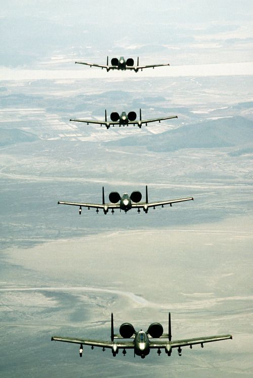 titanium-rain: An air-to-air front view of four 25th Tactical Fighter Squadron A-10  Thunderbolt II aircraft in formation during Exercise Team Spirit '86.