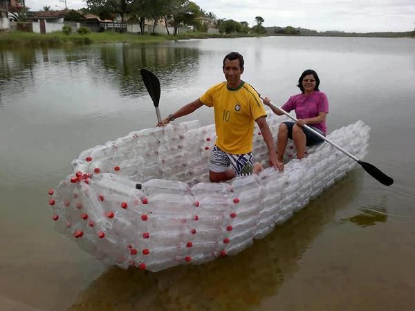 Here A Boat Is Made Entirely Of Plastic Wrapped 2 Liter Bottles Drawn Into