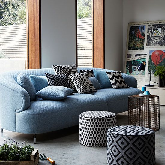 Modern living room with blue sofa and poufs | Living room decorating | Livingetc | Housetohome.co.uk