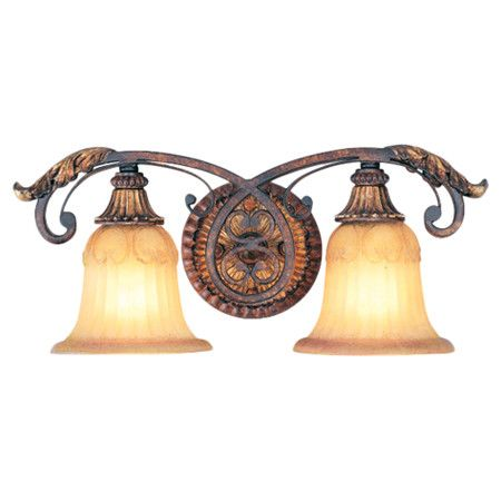 Two-bulb vanity light with art glass shades.   Product: Vanity lightConstruction Material: Metal and glass