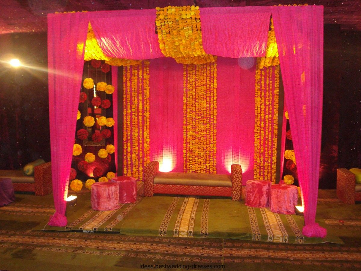 Mehndi And Mayon Decoration : Fuchsia curtains on the big windows. orange garland made of tissue