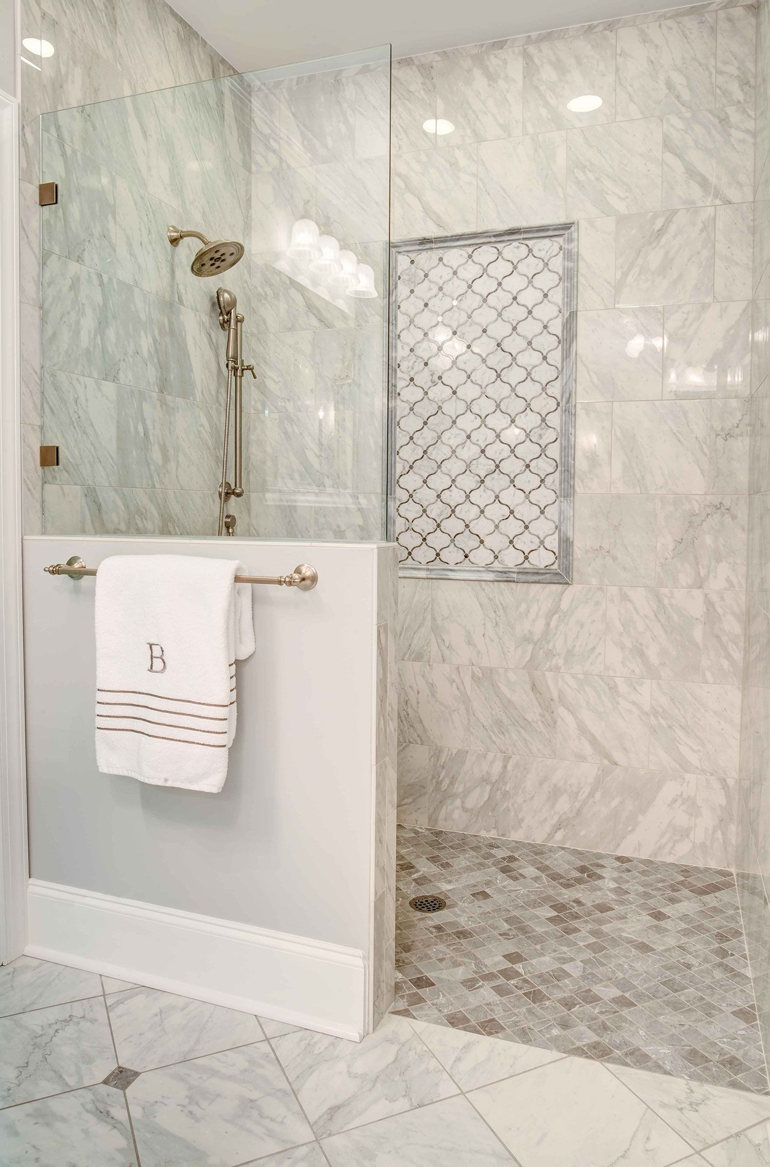 This Fabulous Shower Features A Curbless Doorless Entry For Easy Cleaning The Half Wall With Glass Above In 2020 Half Wall Shower Shower Renovation Glass Shower Doors