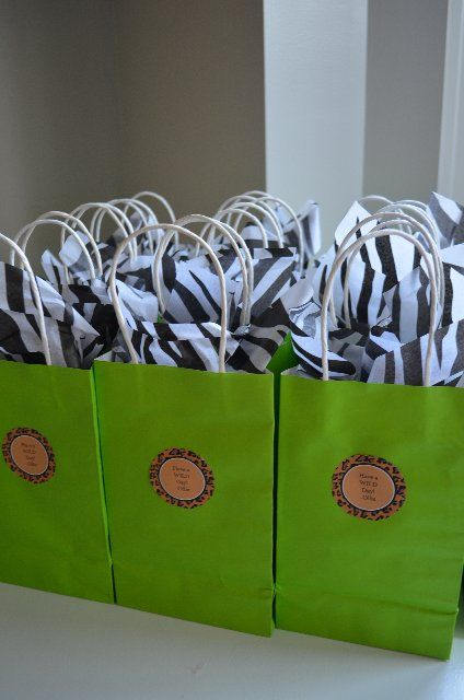 Zoo themed birthday goodie bags could do similar with tiger tissue paper