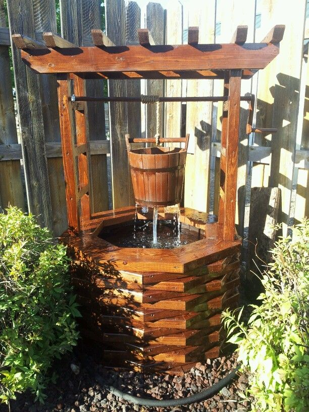 diy wishing well would love this for the backyard could double