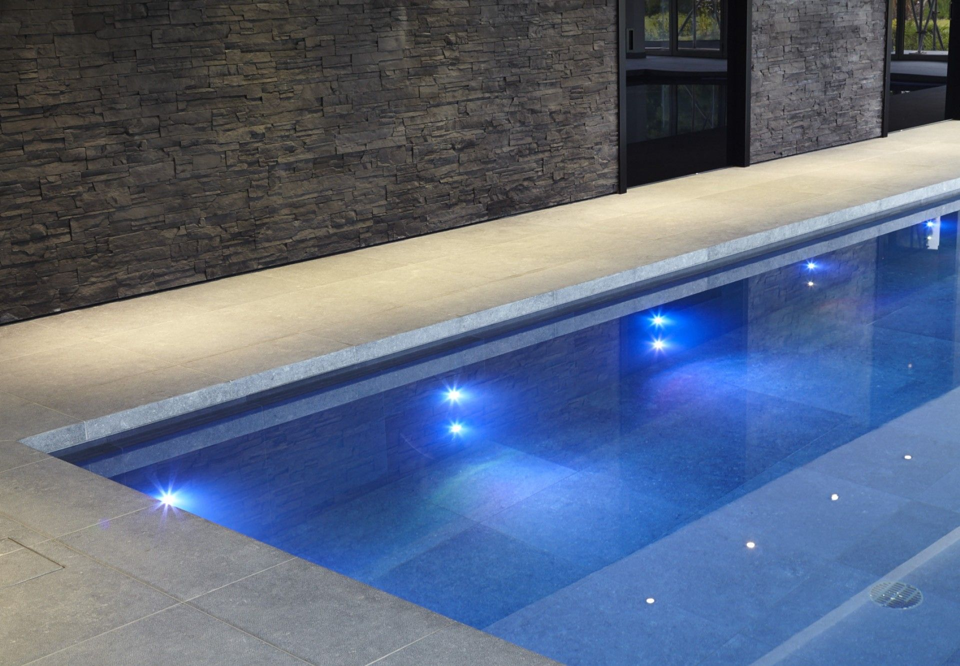 Indoor swimming pool with lighting in Buckinghamshire ...