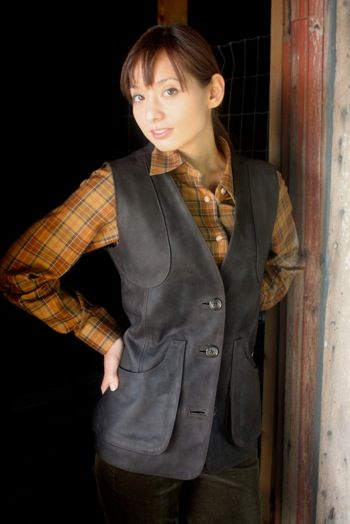 A vest by Really Wild Clothing Company, the brand's Shooting Waistcoat in the 'moss' colorwa