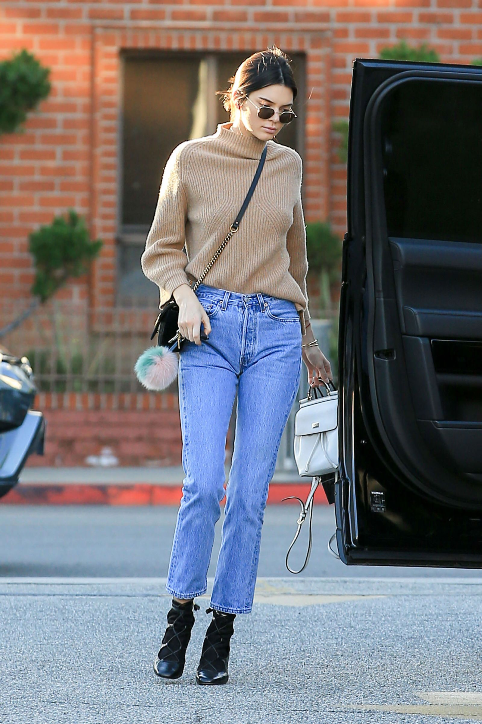 6be0f24b499 Kendall Jenner - In a knit camel turtleneck, high-waisted jeans, lace-up  leather boots, a crossbody bag, white leather backpack and rounded  sunglasses while ...