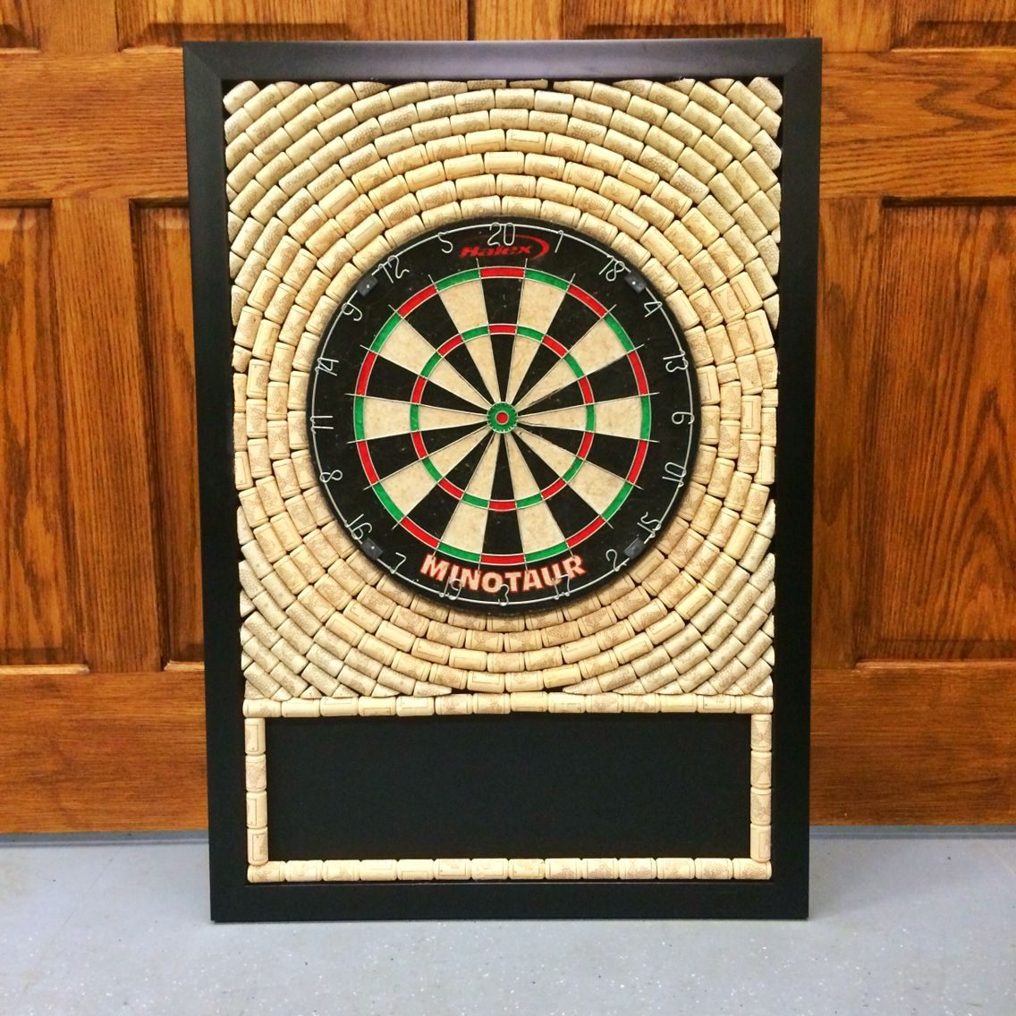 DIY dart board with wine corks and stick on chalkboard. Created by ...