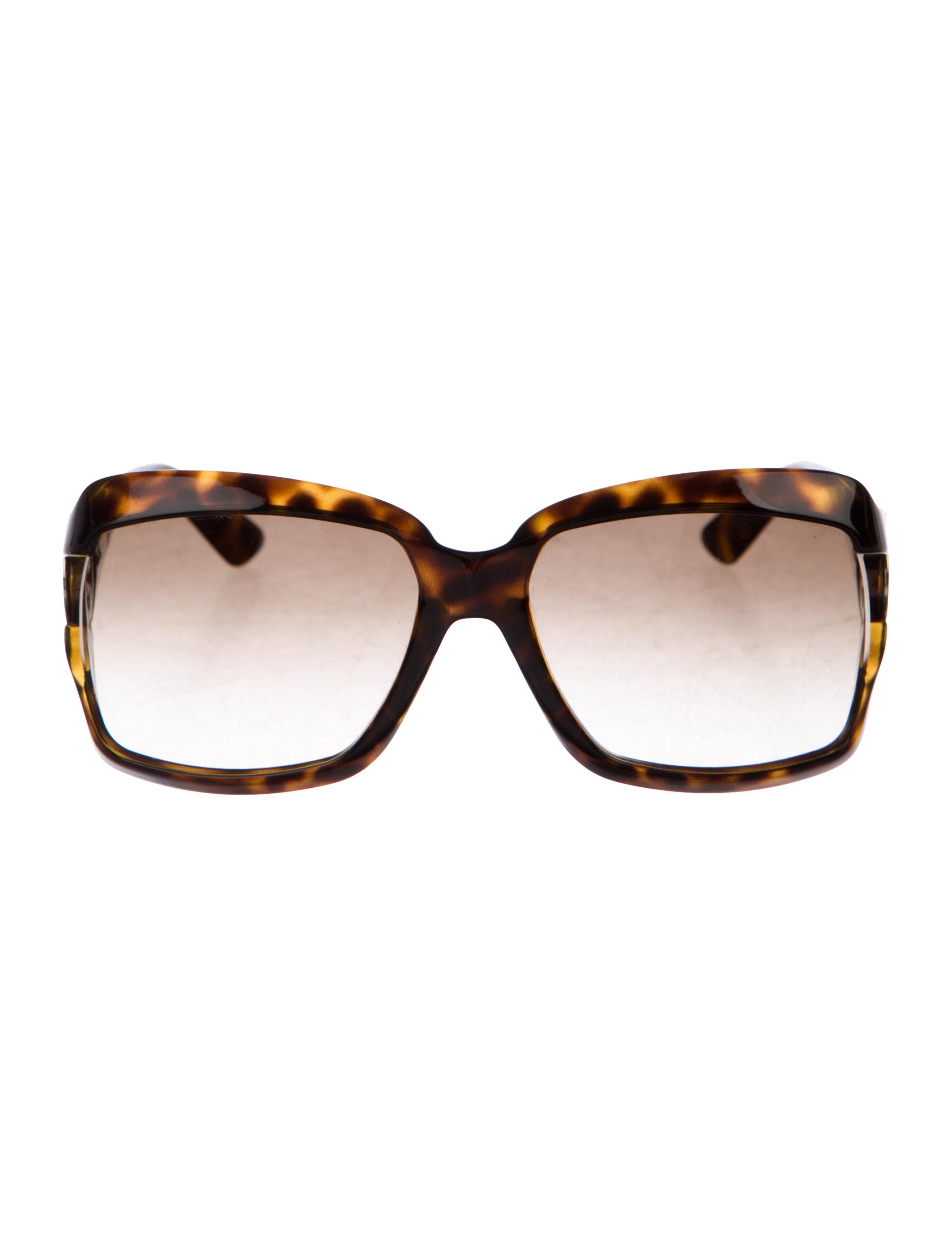 71a2c8603c6 Brown tortoiseshell acetate Gucci sunglasses with gold-tone interlocking GG  at temples and gradient lenses. Includes case.