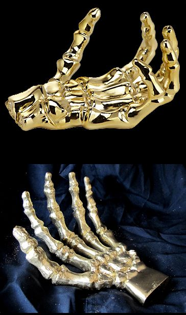 Z Gallerie has this creepy gold skeleton hand (top photo) for $24 I - halloween michaels