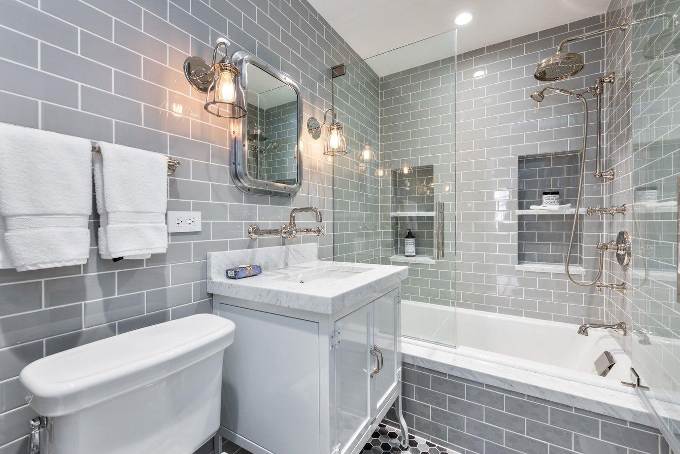 Industrial Condo, Bathroom with light gray subtile tile and wallmounted faucet Bath Industrial by Rae Duncan Interior Design