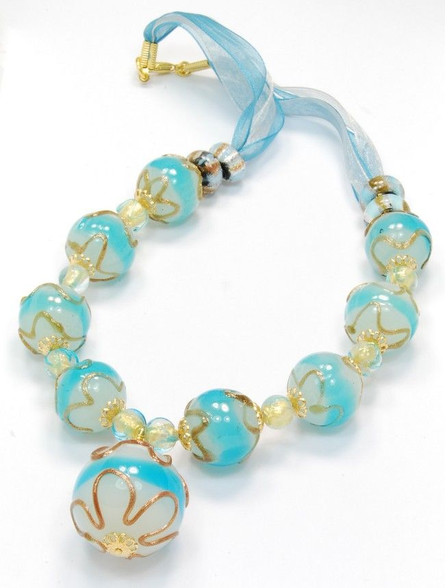 Fascinating murano glass jewelry necklace with big glass beads in fascinating murano glass jewelry necklace with big glass beads in turquoise and white tonality wholesale fashion jewelry made in italy aloadofball Choice Image