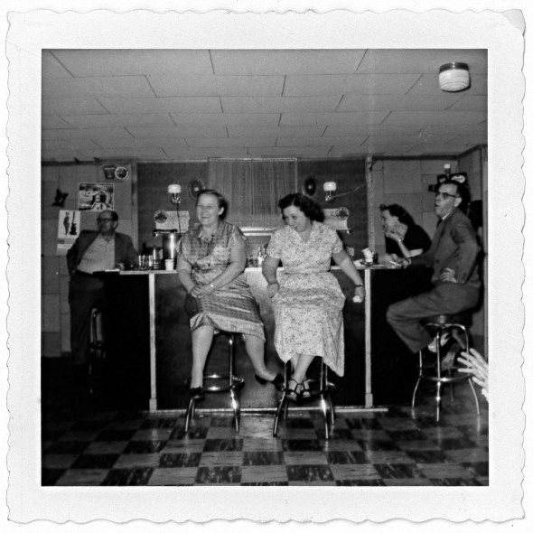 These two ladies from the 1950s look like they were having a grand time one night! Hopefully they were able to stay balanced on their stools while enjoying some good laughter. It appears that they are seated at a bar, possibly at a social hall of sorts. There is no information on the back of this photo unfortunately. #vintagephoto
