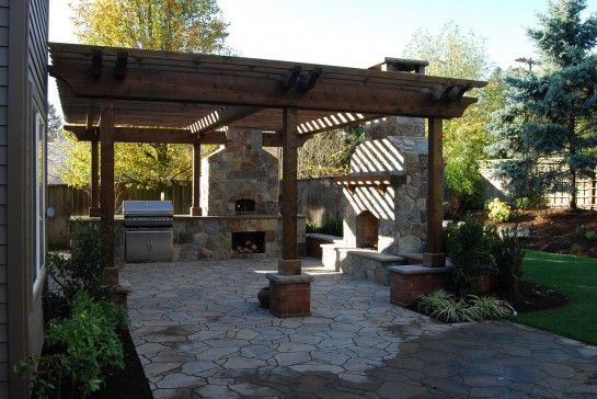 Astounding Outdoor Kitchen Patio Designs With Outdoor Stone Veneer  Fireplace And Outdoor Wood Burning Pizza Oven Also Rustic Timber Pergola  Roofing