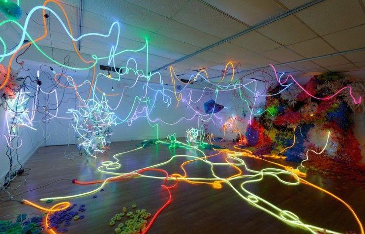 explore the explosive light filled world of romanian artist adela