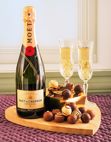 Send your celebrations with a gift hamper of Moet & an variety of delicious truffles. Glasses and board not Included.